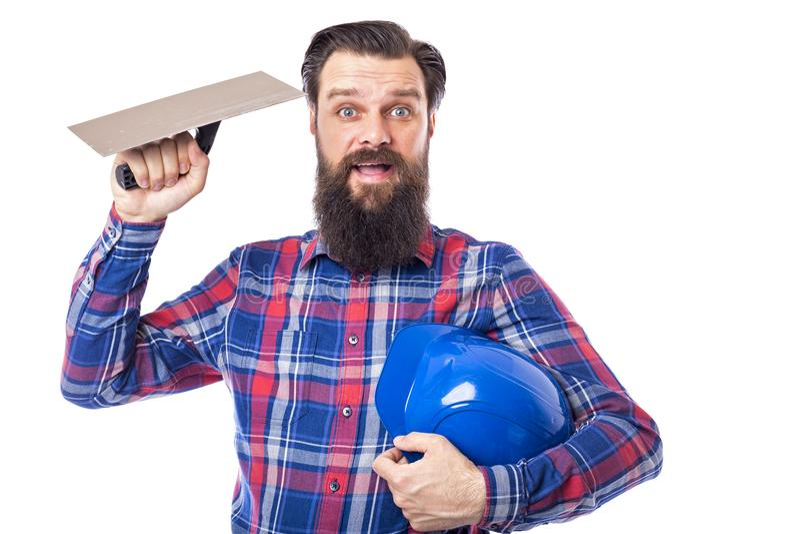 Бородатым инструмент masonry человека используемый удерживанием стоковая фотография rf