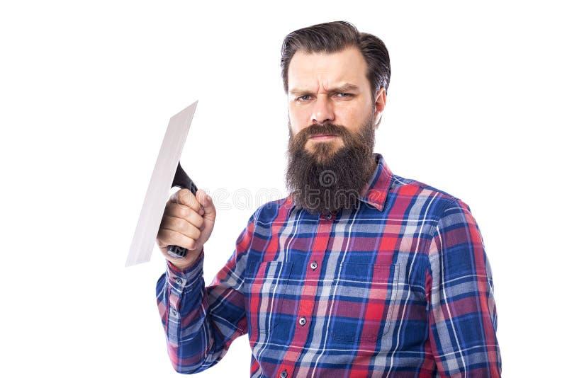 Бородатым инструмент masonry человека используемый удерживанием стоковые изображения rf