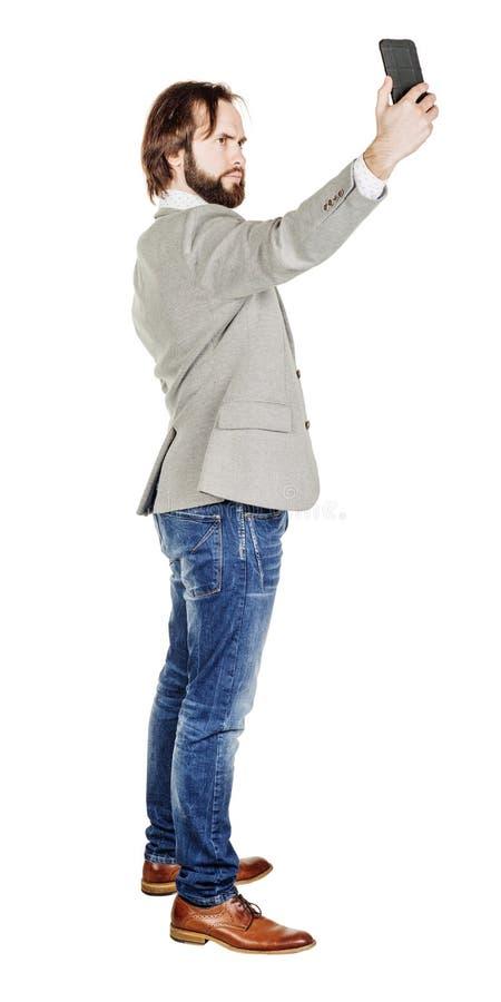Бородатый молодой бизнесмен принимая усмехаться selfie isola портрета стоковые изображения