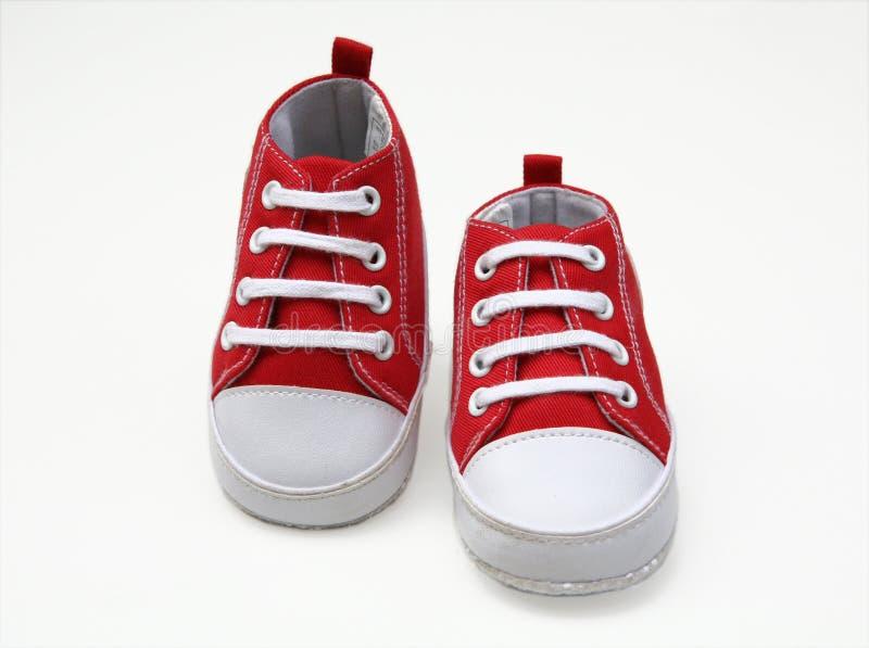 ботинки бегунков младенца стоковые фотографии rf