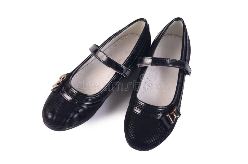 Ботинки женщин черные изолированные на белизне стоковые фотографии rf
