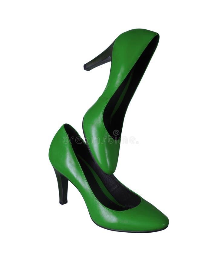 Ботинки зеленого цвета ` s женщин на белой предпосылке стоковые изображения rf