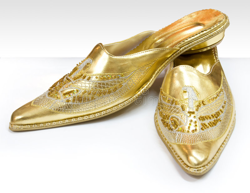 ботинки золота стоковое фото