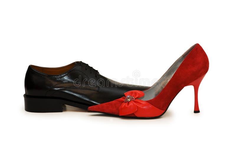 ботинки изолированные чернотой красные стоковое изображение rf
