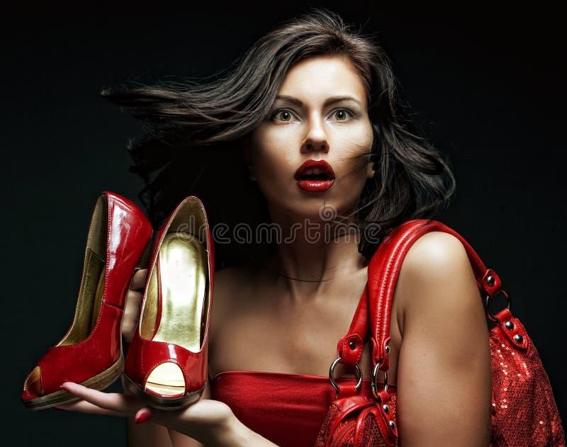 ботинки красного цвета модели способа мешка стоковая фотография rf