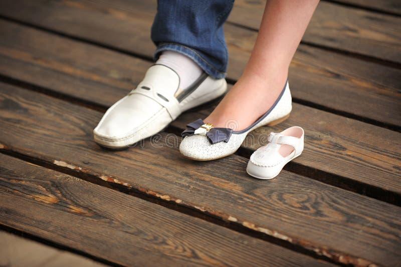 Ботинки семьи стоковые фото