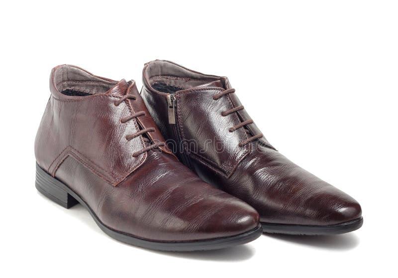 Ботинки ультрамодных людей зимы коричневые стоковые изображения rf