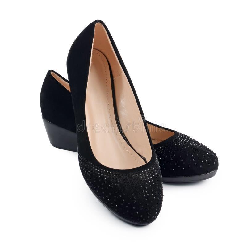 Ботинки черноты ` s женщин на белизне стоковые изображения rf