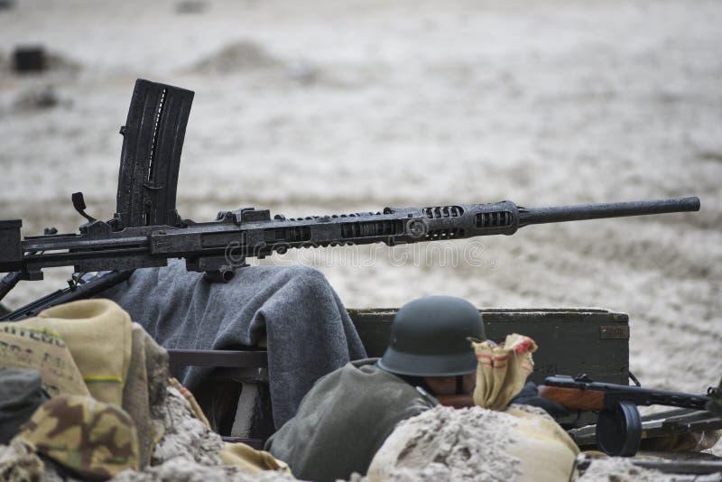 Бочонок пулемета от WWII во время реконструкции сражения стоковое изображение