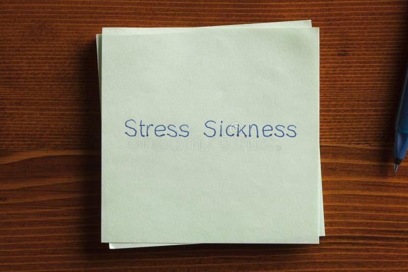 Болезнь стресса написанная на примечании стоковая фотография rf
