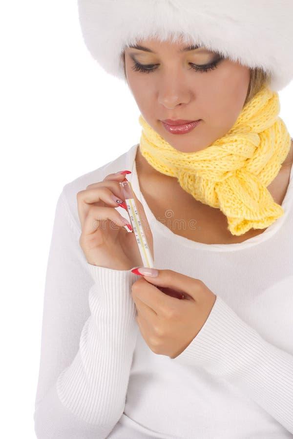 Больной термометр удерживания девушки стоковая фотография rf