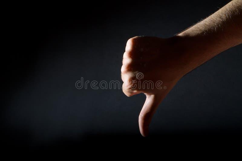 Большие пальцы руки вниз стоковая фотография