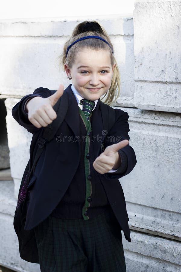 Большие пальцы руки студента вверх стоковое фото rf