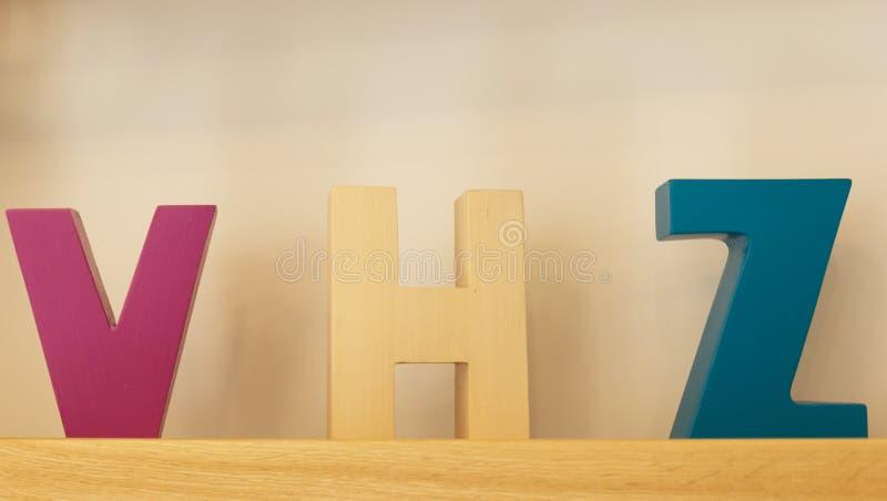 Большие письма на полке стоковое фото rf