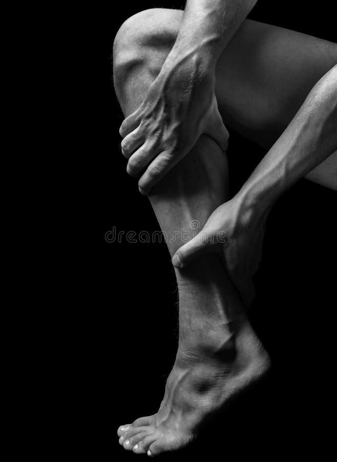 Боль в мышце икры стоковые фотографии rf