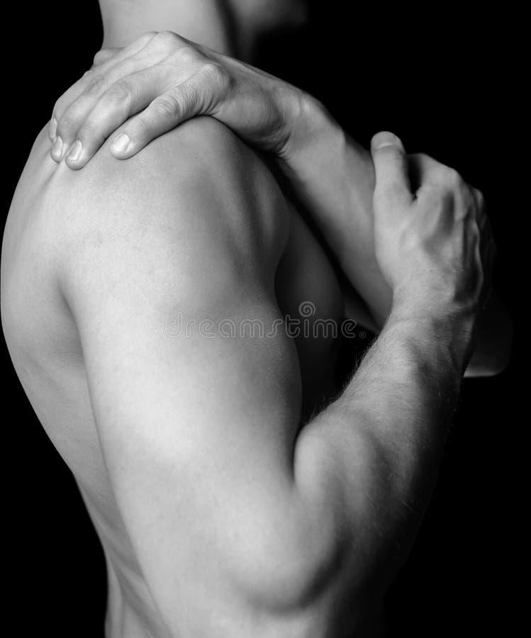 Боль плеча стоковые изображения