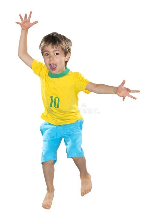 Download Бразильский мальчик, скачущ, желтый и голубой Стоковое Фото - изображение насчитывающей цель, национально: 40575146