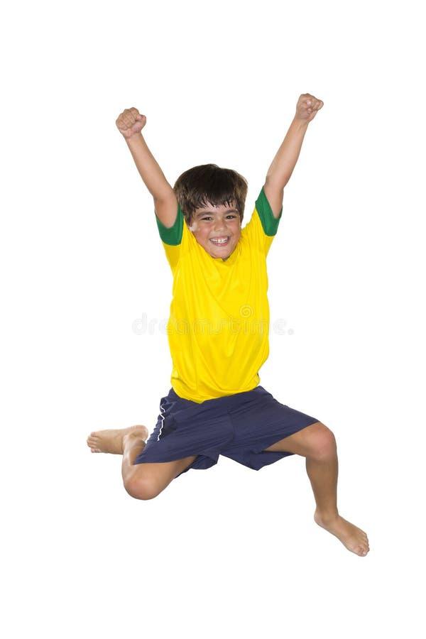 Download Бразильский мальчик, скачущ, желтый и голубой Стоковое Изображение - изображение насчитывающей футбол, бразилии: 40575301