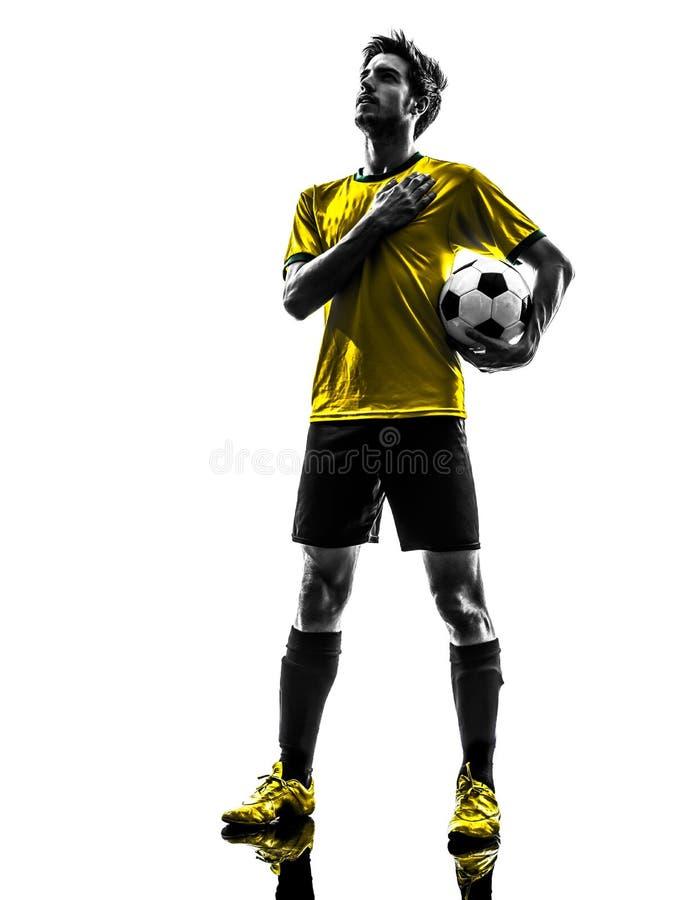 Бразильский силуэт молодого человека футболиста футбола стоковые изображения rf