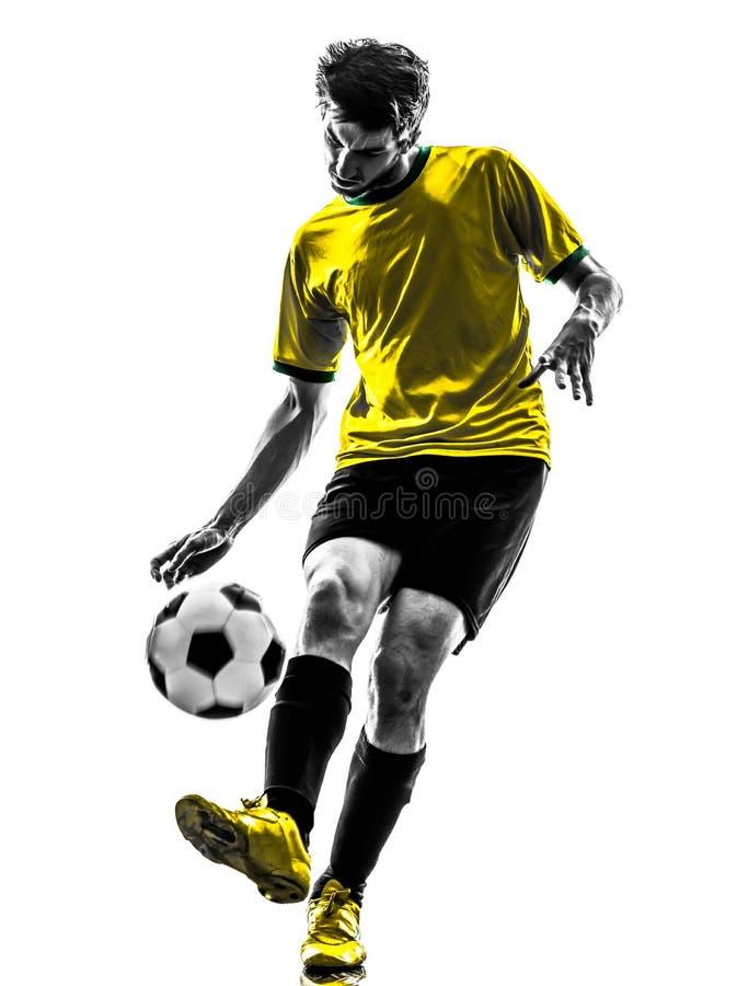 Бразильский силуэт молодого человека футболиста футбола стоковые фотографии rf