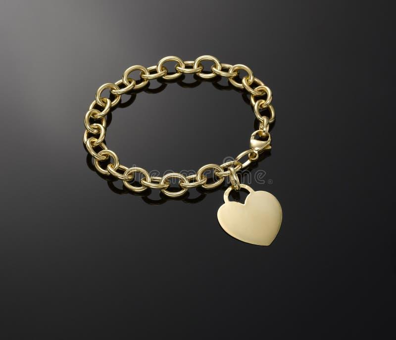 Браслет шкентеля сердца золота стоковое изображение rf