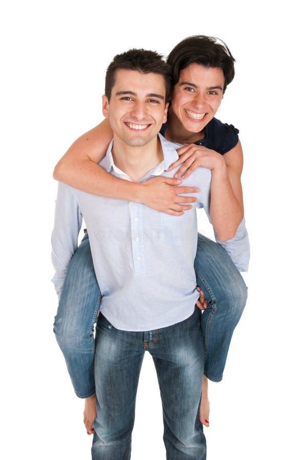 брат дает piggyback стоковое изображение rf