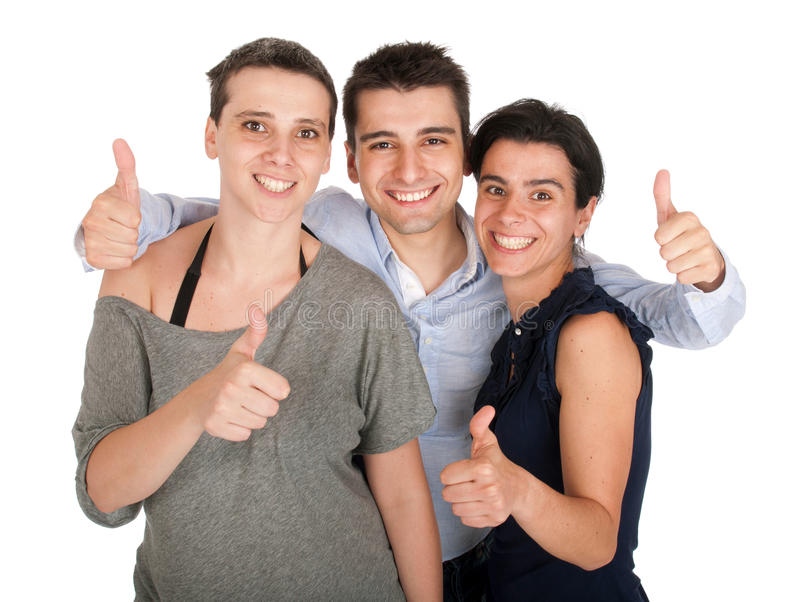 брат показывая сестрам большие пальцы руки вверх стоковое изображение rf