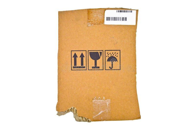 Браун и бежевый покрашенный рифленый картон, предупредительные знаки, штрихкод стоковое изображение