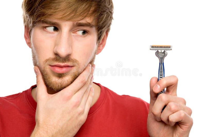 бритва человека удерживания бороды стоковые фото