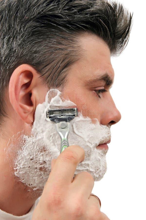 брить человека стоковая фотография