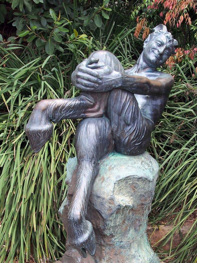 Бронзовая статуя сатира стоковые изображения
