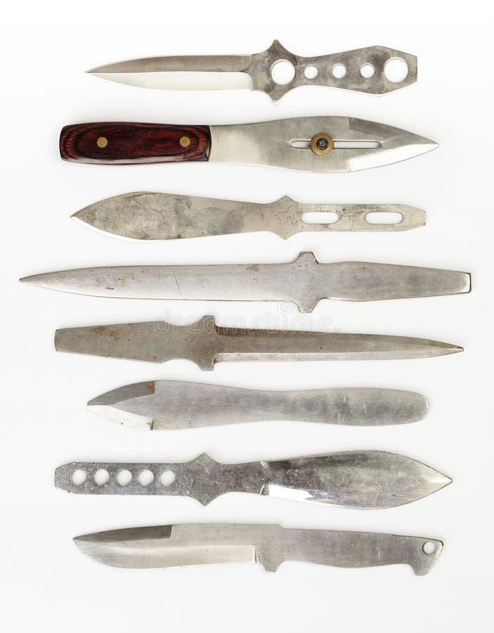 8 бросая ножей на белой предпосылке стоковые изображения rf