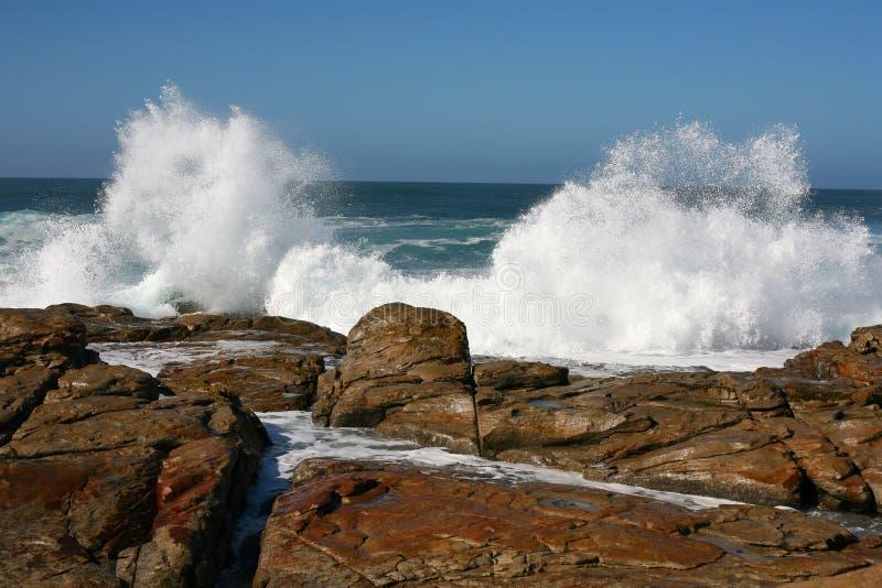 брызгать волны близнеца стоковое фото