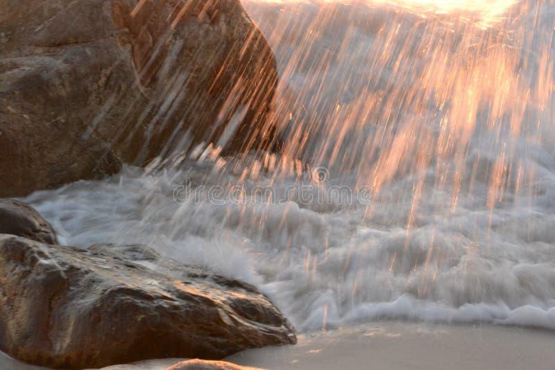 Брызг захода солнца стоковые фотографии rf