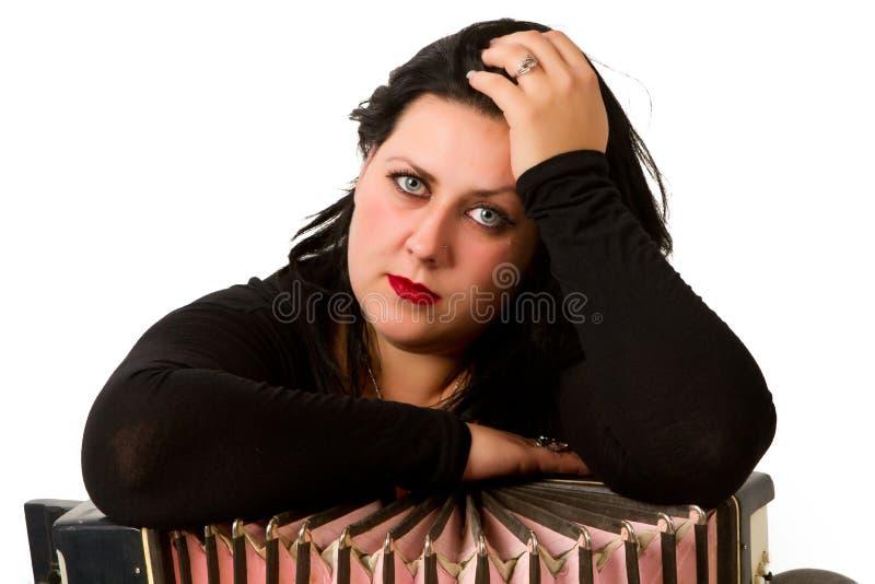 Брюнет с аккордеоном стоковая фотография rf