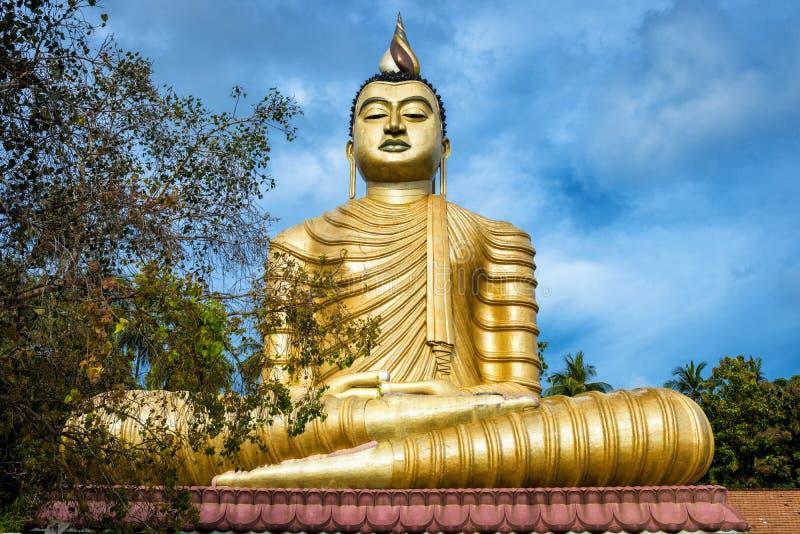 Будда в виске Wewurukannala Vihara старом в городке Dickwella, Шри-Ланка стоковое изображение