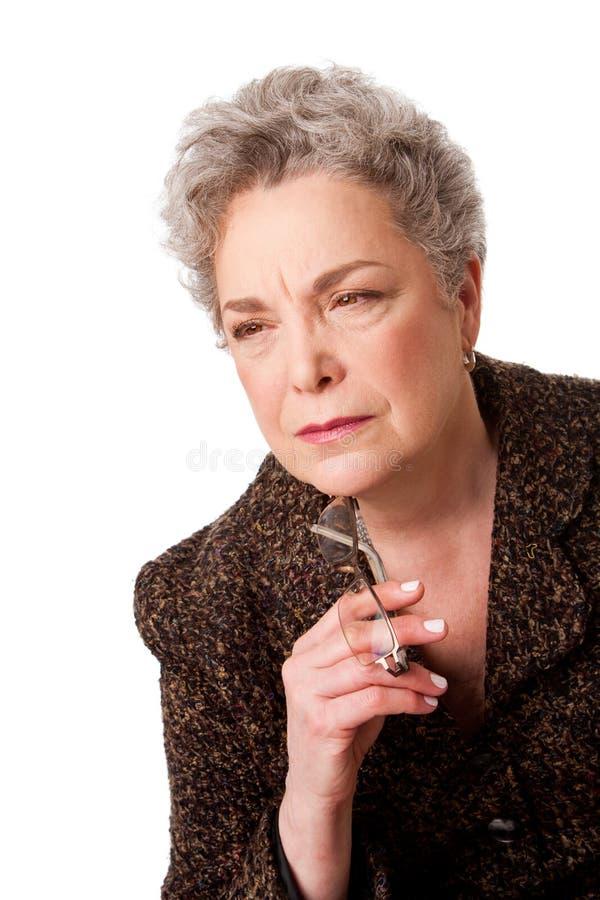 будущая старшая думая женщина стоковые изображения rf
