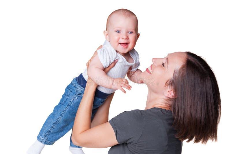 Будьте матерью с smiley младенца 6 месяцев старого стоковые фотографии rf