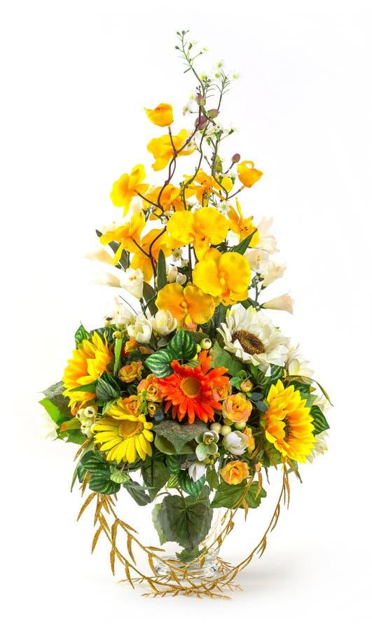 Букет солнцецвета и vanda в стеклянной вазе стоковое изображение
