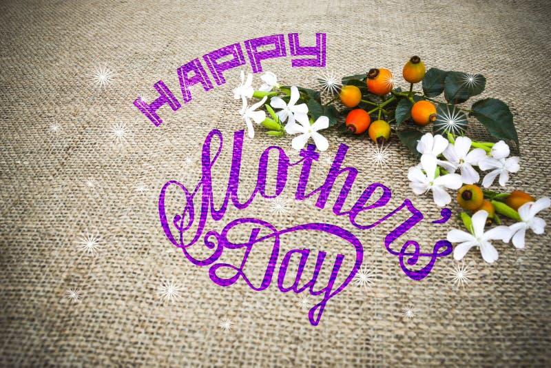 Букет счастливой карточки дня матерей флористический на linen ткани стоковое фото