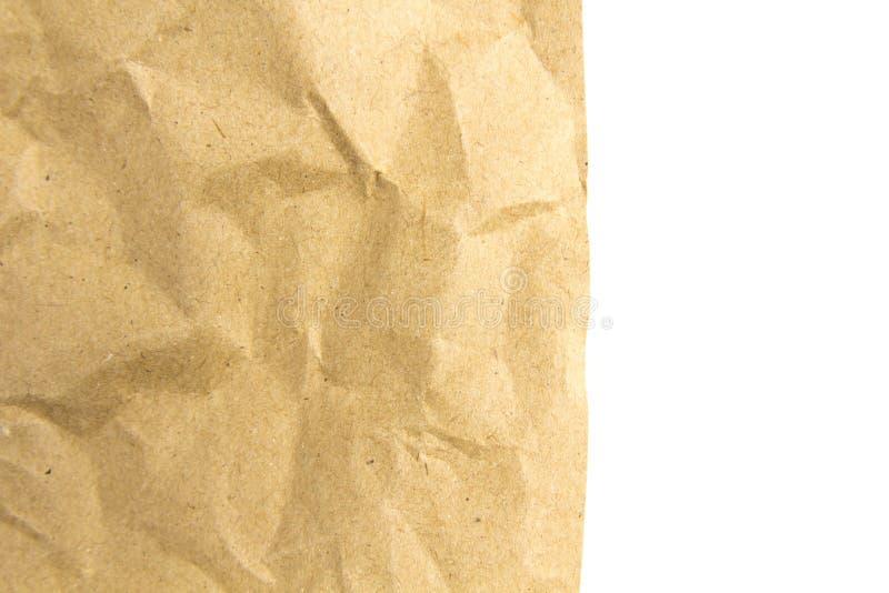 Бумага губительно текстурирует белую предпосылку стоковое фото