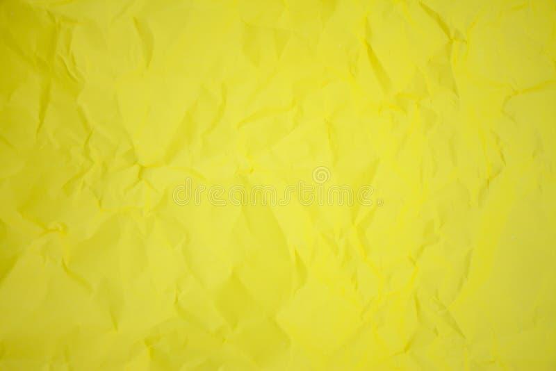 Бумага скомканная желтым цветом стоковые фото