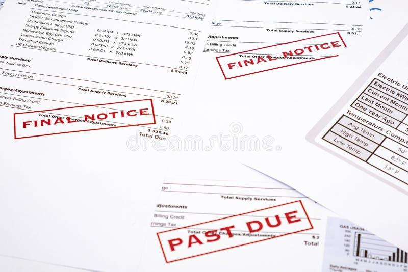 Бумаги концепции и счета за электроэнергию выхода по энергии стоковое изображение