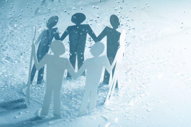 бумажная команда дождя вниз стоковое изображение