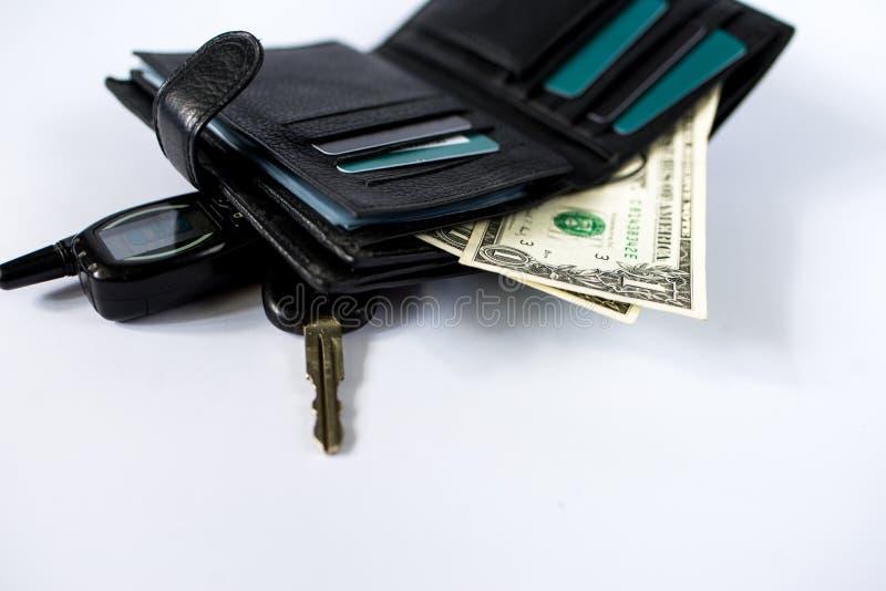 Бумажник с деньгами изолированными на белом искусстве предпосылки стоковое фото