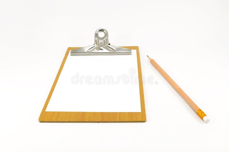 Бумажный блокнот на деревянной плите с карандашем стоковые фото