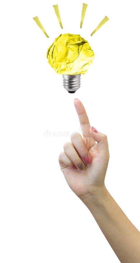 Бумажный свет шарика на кончике пальца женщин на белой предпосылке стоковое фото rf