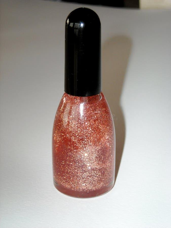 Бутылка glittery лака для ногтей стоковое фото rf