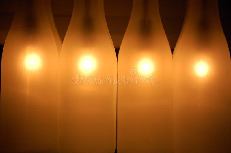 бутылки доят просвечивающее стоковое изображение