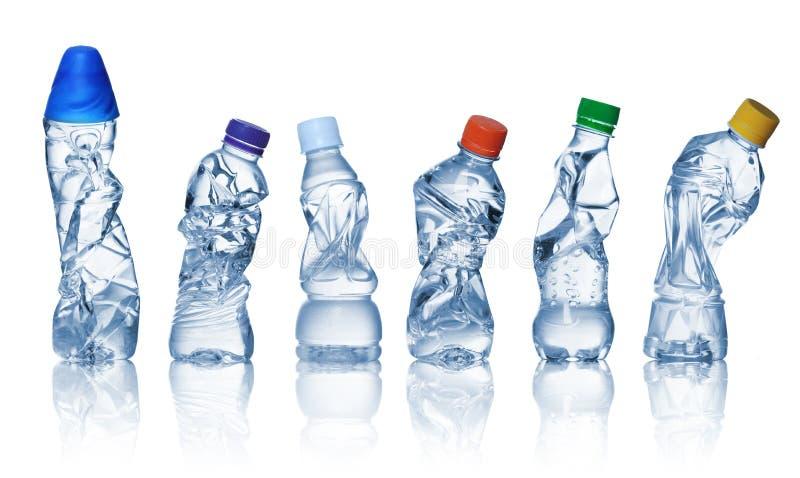 бутылки опорожняют используемую пластмассу стоковое фото